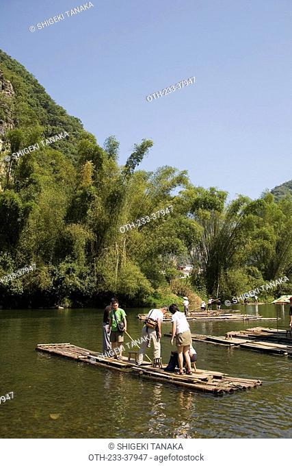 Bamboo raft tour at Big banyan tree park Darongshu park, Yangshuo, Guilin, China