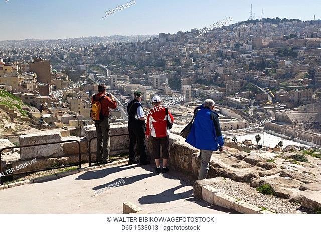 Jordan, Amman, elevated city view from the Citadel with people, NR