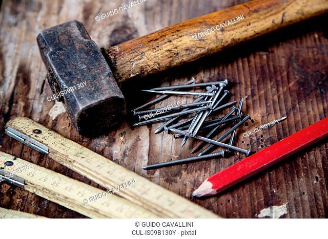 Pencil, nails, hammer, zig zag ruler