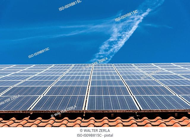 Solar panels on roof, low angle view, Munich, Germany