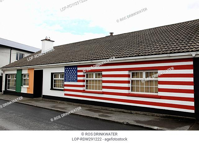 Republic of Ireland, County Offaly, Moneygall. Moneygall house painted with the Stars and Stripes of the US flag and Irish tricolor in celebration of the visit...