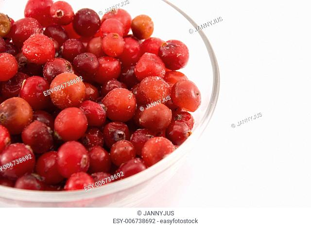 glass bowl with cranberries isolated on white
