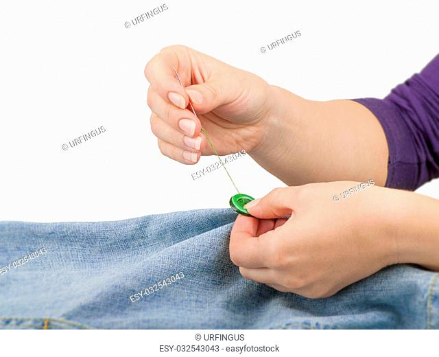Hand sewing jeans Stock Photos and Images | age fotostock