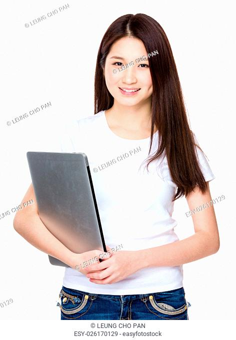 Woman holding with laptop computer