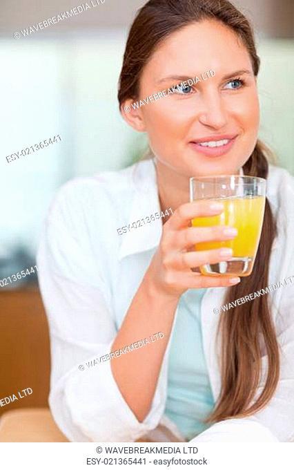 Portrait of a happy woman drinking juice