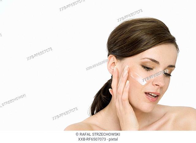 woman creaming face