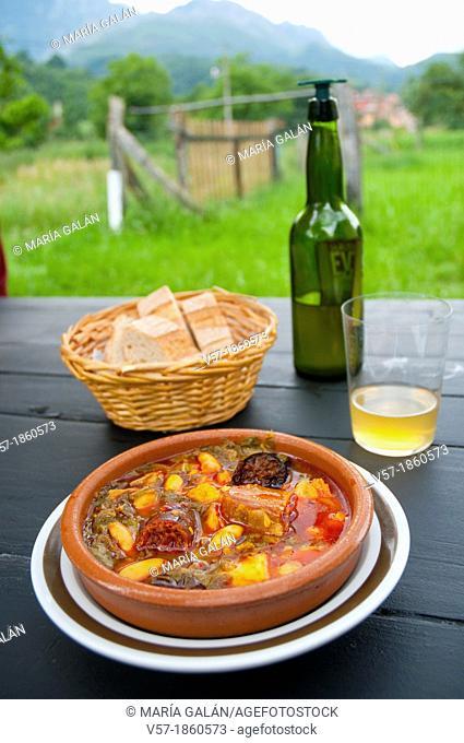 Pote asturiano serving with cider. Asturias, Spain