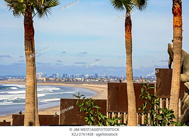 Tijuana, Mexico - The U. S. -Mexico border fence where it meets the Pacific Ocean. San Diego, California is up the beach to the north