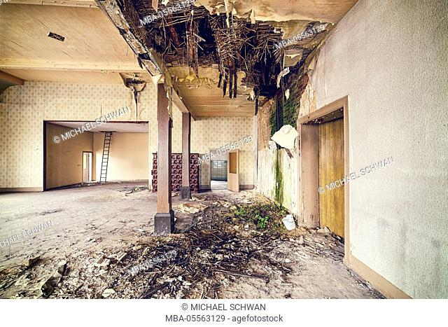 Decayed ballroom with collapsed ceiling