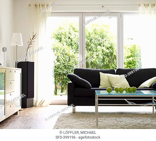 Living room with grey sofa and green apples on table