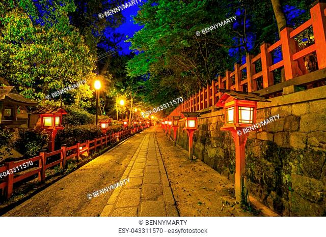 Illuminated path at night from the red lanterns leading from Yasaka Shrine to the Gion weeping cherry tree in Maruyama Park