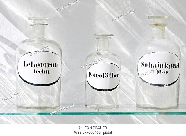 Germany, Bavaria, Munich, Old pharmacy flask in window display