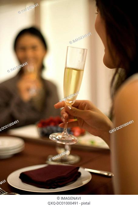 Woman drinking a glass of champagne