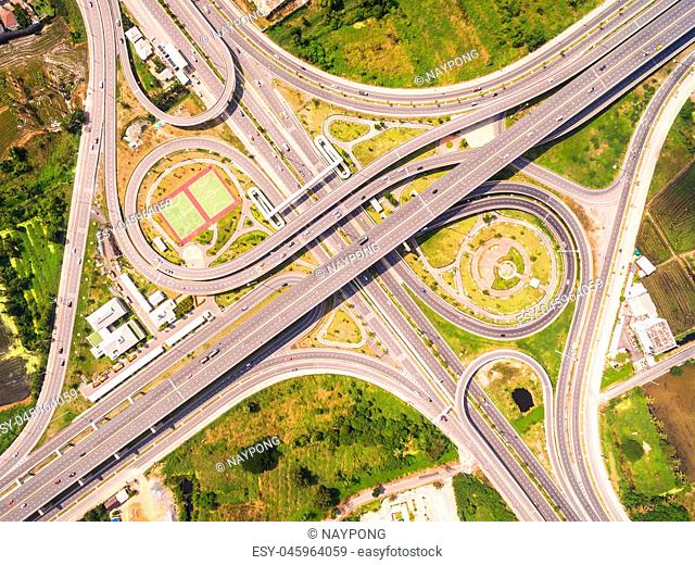 Top view over the road and highway, Aerial shot of highway interchange of a city, Shot from drone