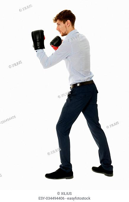 Young businessman fighter in a combat posture, ready to take on any opponent