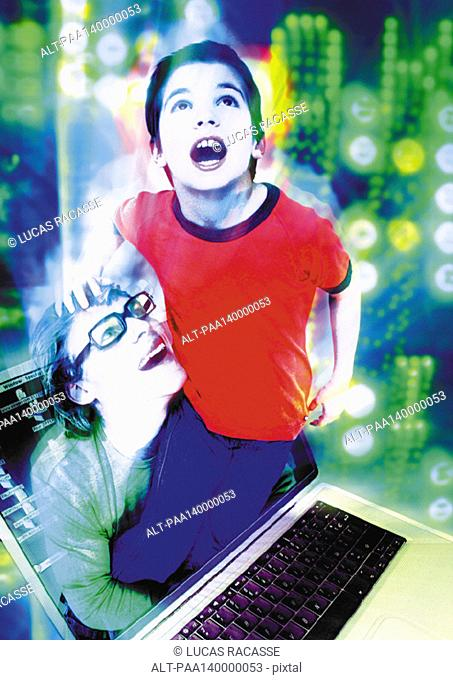 Child emerging from laptop entering into cyberspace, man lifting child, digital composite
