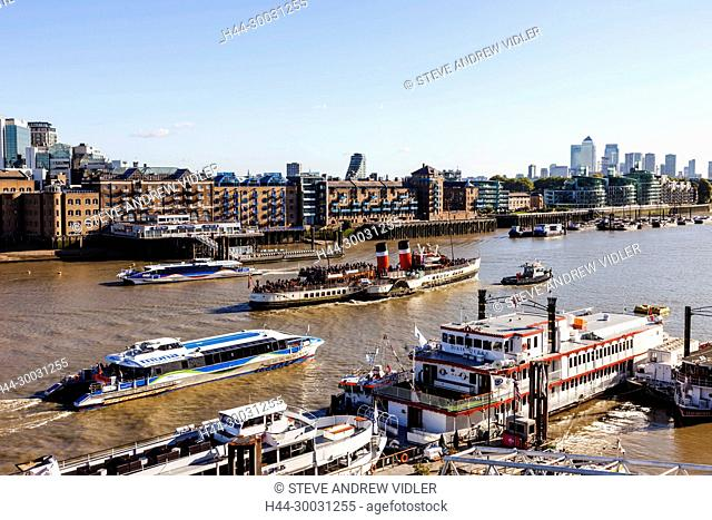 England, London, Boats on The River Thames and Docklands Skyline