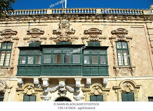 A traditional Maltese green wooden balcony on a building in St George's Square, Valletta, Malta now known as Palace Square