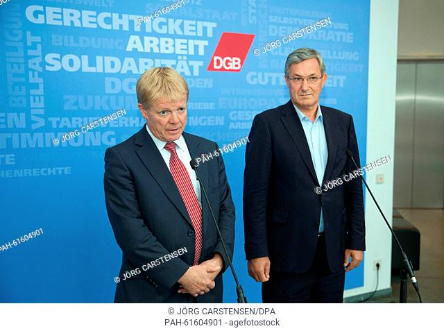 Rainer Hoffmann (L), president of union umbrella organisation Confederation of German Trade Unions (DGB), and Bernd Riexinger