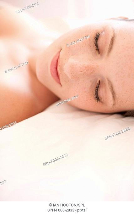 MODEL RELEASED. Young woman resting