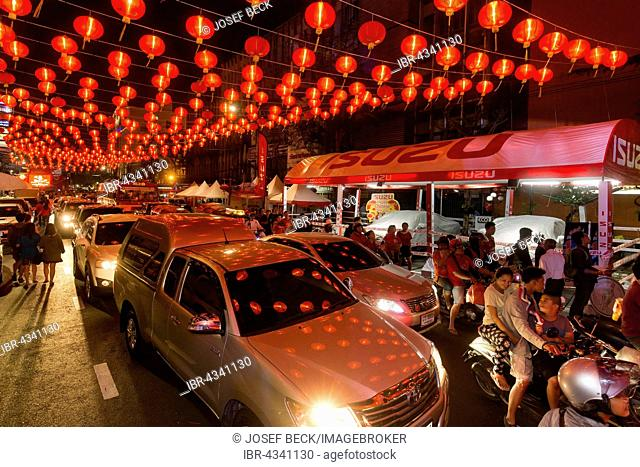 Red chinese lanterns reflecting on cars, Chinese New Year, traffic in Yaowarat Road, Spring festival, Chinatown, District Samphanthawong, Bangkok, Thailand