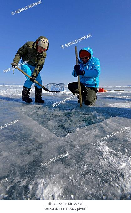Russia, Lake Baikal, preparation of an ice hole for ice diving