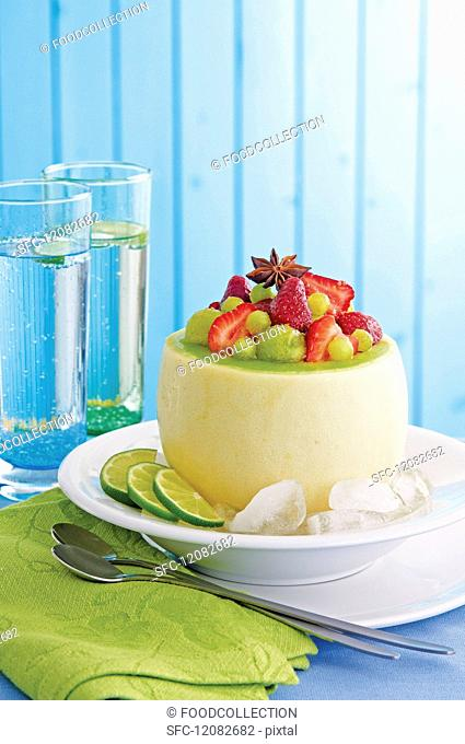 Strawberry & melon salad with ginger in an hollowed out melon