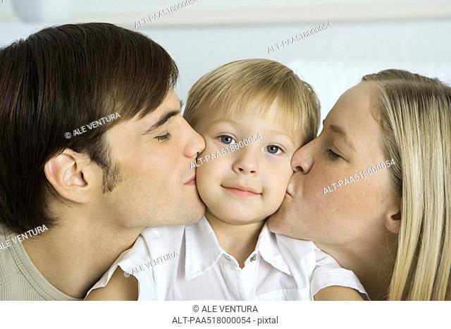 Little boy kiss stock photos and images age fotostock parents kissing little boys cheeks boy smiling at camera altavistaventures Choice Image