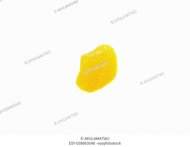 Yellow colored sugar jelly candy over white background
