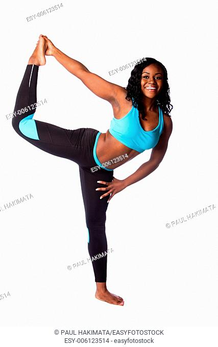 Beautiful happy woman standing on one leg stretching workout fitness exercise, bodycare concept