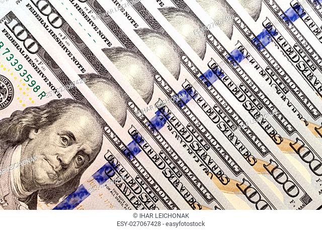 put together the American dollars. Photo close-up of banknotes on 100