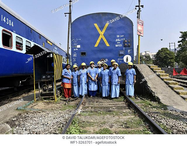 Guwahati, Assam, India. March 6, 2019. Women workers of the Northeast Frontier Railway working at Guwahati Railway Station
