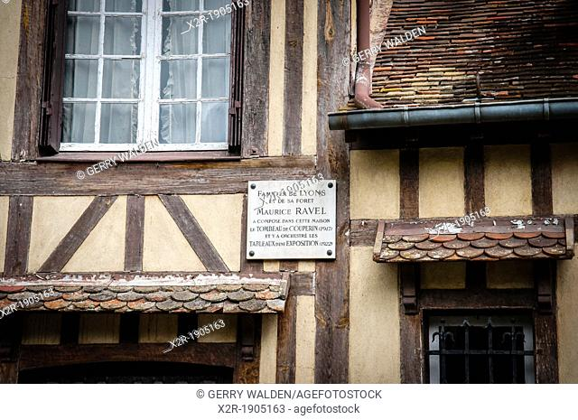 Historic half timbered building in rue d'Enfer in the pretty market town of Lyons la Forêt in Haute Normandie, France  There is a plaque on the wall of the...