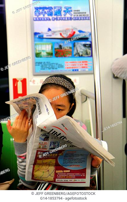 China, Shanghai, Huangpu District, East Nanjing Road Metro Station, subway, public transportation, Green Line 2, Mandarin symbols, hanzi, Asian, woman, reading