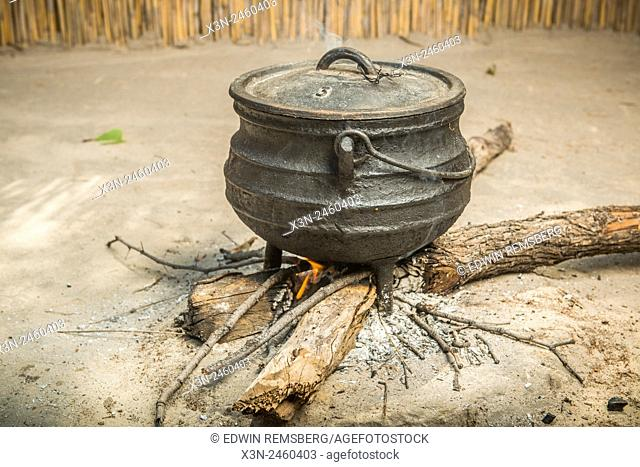 Maun, Botswana- Sexaxa Village Cooking Sorghum for the Family