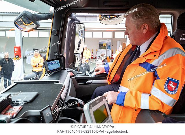 04 April 2019, Lower Saxony, Hannover: Lower Saxony's Transport Minister Bernd Althusmann (CDU) observes the additional monitor in the driver's cab of a truck...