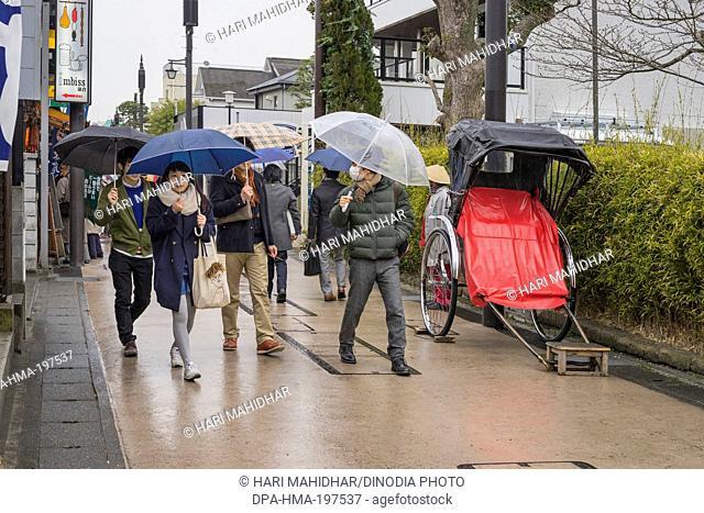 Pedestrians walking on street, kamakura, japan
