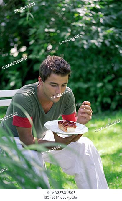 Young man eating dessert