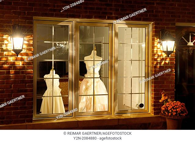 Dress shop window at night in historic Kleinberg Ontario