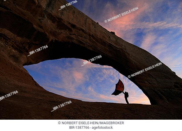 Tent, hiker, trekking, Wilson Arch, Moab, Utah, USA