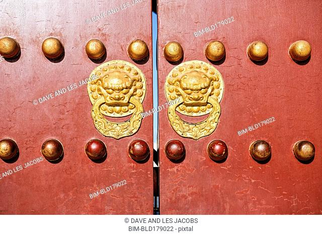 Ornate knockers on traditional doors