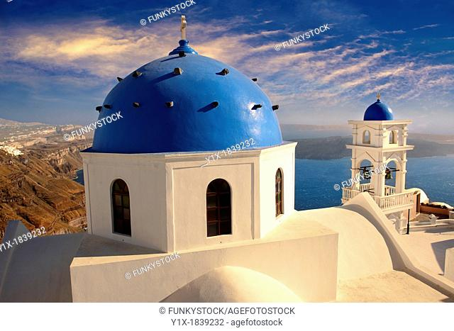 Oia, Ia  Santorini - Blue domed Byzantine Orthodox churches, - Greek Cyclades islands