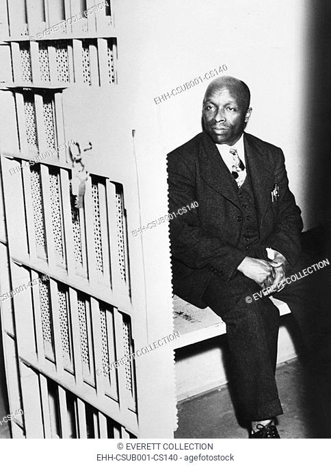 Father Divine sitting in a jail cell, April 21, 1937. Harry Green was stabbed when a Peace Mission Movement meeting in NYC turned violent when two men tried to...