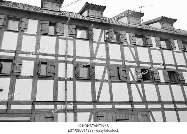 Old building in center of Klaipeda at cloudy winter day, Lithuania. Black and white