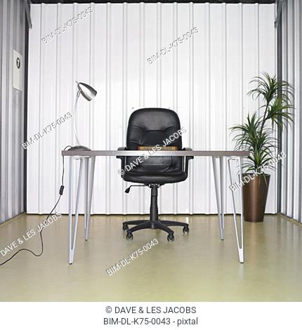 Desk and chair in storage unit