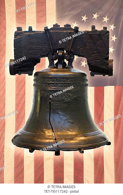 Liberty Bell and American flag with thirteen stars