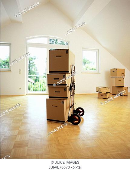 View of unpacked boxes in an empty room