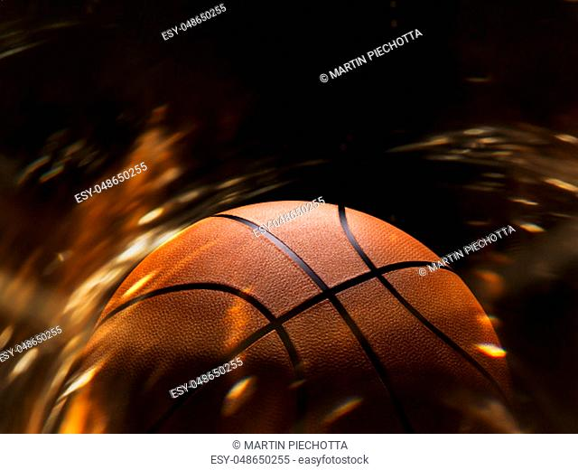 Basketball close-up on black background with bokeh, spotlights and fire