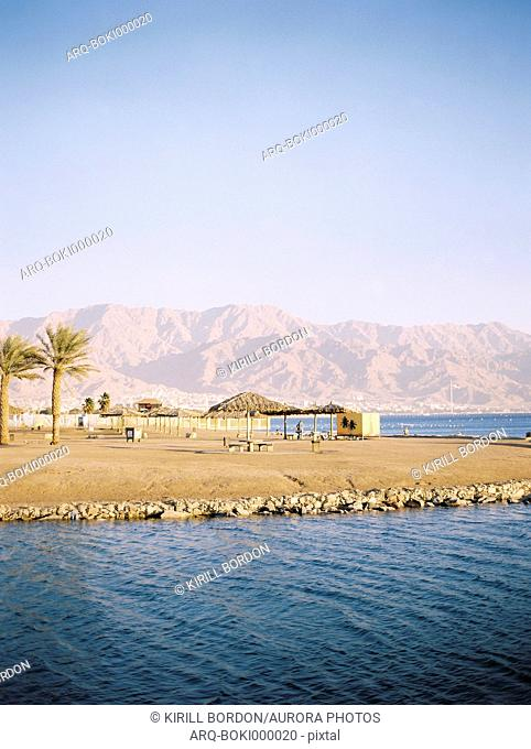 Red Sea view in Eilat, Southern District, Israel showing mountains of Jordan in the background