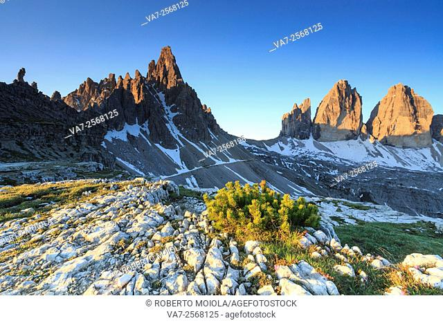 Dawn illuminates the Three peaks of Lavaredo and Mount Paterno. Sesto Dolomites Trentino Alto Adige Italy Europe